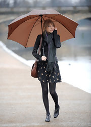 Taylor Swift bundled up at the Princess of Wales Memorial in a charcoal scarf.