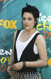 Kristen embraces her punk rock look with simple leather bracelets.