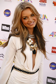 Havana Brown complemented her look with a flower statement necklace made of pearls, gemstones, and gold chains.