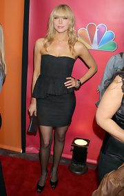 Laura rocked fall's hottest trend in a black strapless dress complete with peplum detailing.