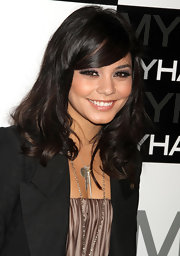 Vanessa Hudgens paired her sharp blazer with a feather pendant silver chain necklace.