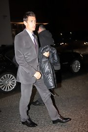 Miroslav Klose finished off a gray pant suit with black patent leather shoes.