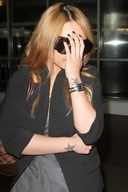 Tila showed off her star tattoo while arriving at LAX airport.
