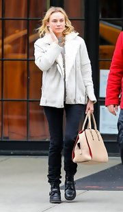 Diane Kruger sported a casual zip-up jacket with fur trim for her lazy day in NYC.