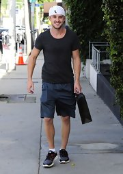 Tom Felton traded in his wizarding robes for a basic tee and sports shorts while out shopping.