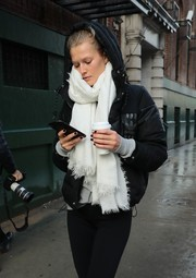 Toni Garrn bundled up in a white scarf and a black puffer jacket for a stroll in New York City.