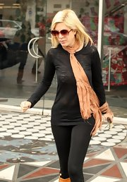 Tori wears a sheer burn out black tee while out shopping in LA.