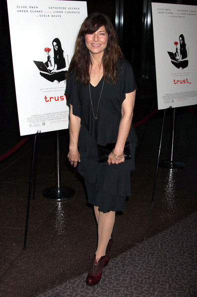 Catherine wears a dark cocktail dress with layers of ruffles for the 'Trust' premiere in LA.
