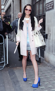 Tulisa Contostavlos left the Radio 1 studio in London wearing a bold pair of bright blue platform pumps.