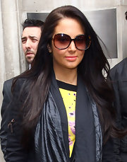 Tulisa Contostavlos wore her long hair styled in sleek subtle layers for a visit to BBC Studios in London.