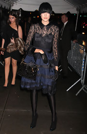 Agyness showed off a patent leather shoulder bag while hitting 'The Twilight Saga' premiere.
