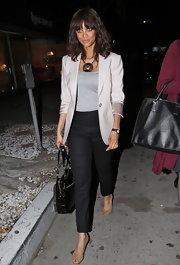Tyra smiles with her eyes while she wears an ecru blazer for her night out in LA.