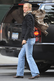 A low-key Uma Thurman was spotted in a black blazer and pale bootcut jeans in NYC.