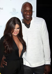 Lamar Odom kept it simple with a white V-neck sweater and jeans at the Unbreakable Fragrance launch.