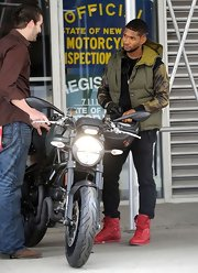 Usher took a spin on his motorcycle in style with this forest green puffer vest.