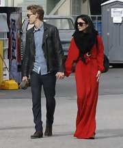 Vanessa Hudgens looked like a modern day Bianca Jagger in this long red gauzy dress on her way to church.