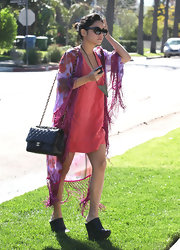 Vanessa Hudgens choice of a ladylike quilted Chanel bag was surprising given her eclectic outfit.