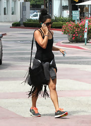 A swingy fringe bag added Western cool to Vanessa's workout outfit.