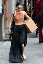 For her footwear, Vanessa Hudgens kept it comfy with gold Birkenstock sandals.