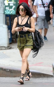 A fringed black leather backpack added a boho touch to Vanessa Hudgens' outfit.