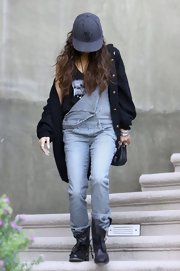 Vanessa Hudgens paired a super slouchy cardigan with a pair of striped overalls.