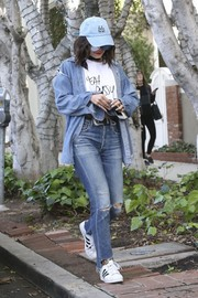 Vanessa Hudgens kept her feet comfy in white leather sneakers by Adidas.