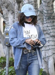 Vanessa Hudgens topped off her denim look with a baseball cap by The Style Club.