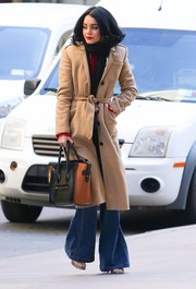 Vanessa Hudgens looked like she just stepped out of the '70s in her beige coat and flare jeans!