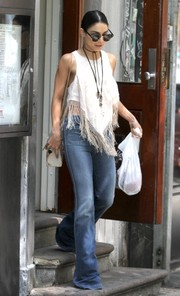 Vanessa Hudgens topped off her hippie-chic attire with a fringed white crop-top.