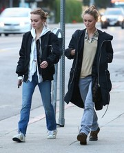 Lily-Rose Depp rounded out her ensemble with white leather sneakers by Adidas.