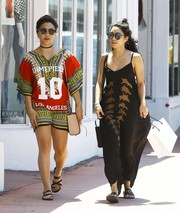 Stella Hudgens completed her daytime outfit with strappy, flat sandals.