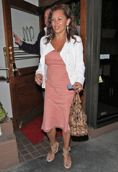 8942c0fc3f78 Vanessa Williams kept her look casual with a pair of woven beige espadrille  wedges.