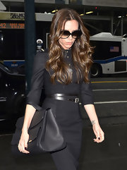 Victoria Beckham kept her modern minimalism ladylike with a top handle satchel.