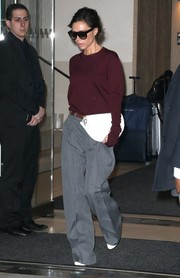 Victoria Beckham teamed her top with gray wide-leg pants, also from her brand.