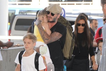 Victoria Beckham;Romeo Beckham The Beckham Family Departing On A Flight At LAX