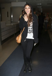 It would take more than a black hoodie to disguise the pretty face of Victoria Justice at LAX.