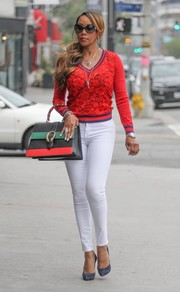 Vivica A. Fox was street-chic in a subtly printed red V-neck sweater while filming her show in Beverly Hills.