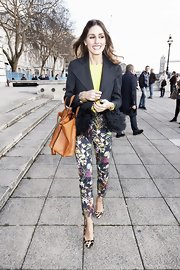 Olivia Palermo embraced the printed pants trend in a pair of cropped floral slacks.