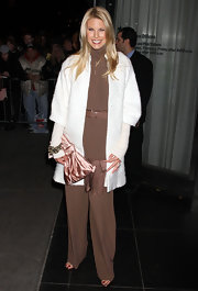 Beth Ostrosky-Stern embraced winter white at the 'W.E.' screening in a textured coat with cropped sleeves.