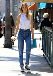 Whitney Port stepped out in New York City rocking a tattered tank top.