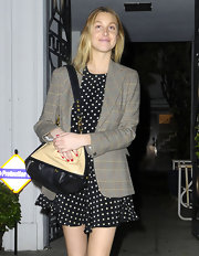 Whitney Port accessorized her charming polka-dots with a two-tone leather satchel.