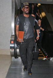 will.i.am rocked a silver embellished tee while traveling.