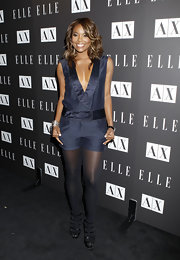 Gabrielle looked sexy and sophisticated with a plunging neckline, while covering up on bottom with sheer tights and multi strap ankle booties.
