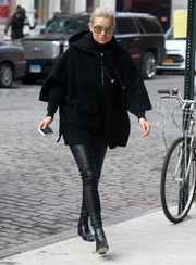 Yolanda Hadid was spotted outside daughter Gigi's apartment wearing a loose, hooded poncho and leather skinnies.