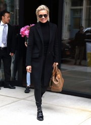 Yolanda Hadid kept it subdued in an all-black coat, turtleneck, and leather pants combo while out in New York City.