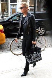 Yolanda Hadid was spotted out in New York City carrying a funky graffiti-print tote by Celine.