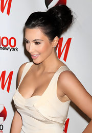 Kim Kardashian added some height to her look with a high bun full of volume and texture.