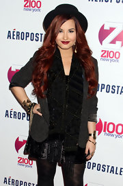 Demi Lovato attended the 2011 Jingle Ball wearing a fringed patterened scarf.