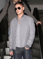 Zac wore a solid gray Letterman jacket with jeans for his casual-cool look at the airport.