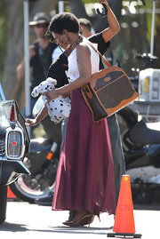 While filming on the set of 'Nina,' Zoe Saldana toted around this structured oversized LV satchel.